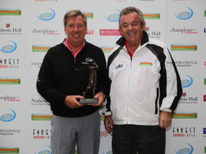 Barry Lane (left) being presented with the championship trophy by Tony Jacklin CBE